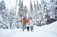 Happy young people having fun on winter day in forest Stock Photos