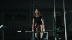 Middle view ,girl lifting weight deadlift at gym, lowlight Stock Footage