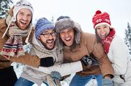Happy young people enjoying winter day Stock Photos