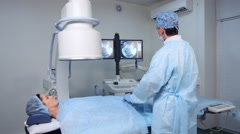 Radiologist performing endovascular surgery operation Stock Footage