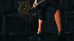 Woman trains at gym. Deadlift closeup. Lowlight Stock Footage