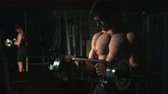 Bodybuilder , man exercising biceps at gym Stock Footage