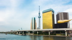 Pan Blue Sky Timelapse Tokyo Skytree Buildings Sumida-Gawa River Cruise Boats Stock Footage