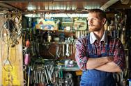 Portrait of man in coveralls in his workshop Stock Photos