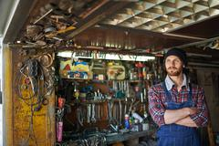 Private entrepreneur and his little workshop Stock Photos