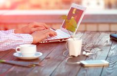 Freelance work at wood Table located on outdoor terrace Stock Photos
