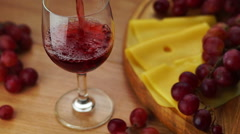 Pouring Red Wine Into Glass. Stock Footage