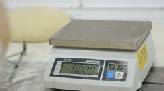 Weighing Bread Dough Using Electronic Scales Stock Footage