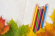 Fall leaves and color pencils Stock Photos