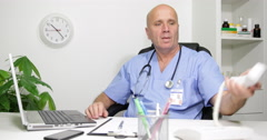 Busy Doctor Working on Laptop in Office Answer Telephone and Talk to Patients Stock Footage