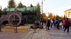 Moscow, Russia - October 09.2016. Tourists consider the Tsar Cannon in Kremlin Stock Footage