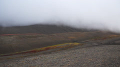 Mountains among clouds. Svalbard, Spitzbergen Stock Footage