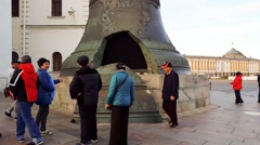 Moscow, Russia - October 09.2016. Tourists consider the Tsar Bell in Kremlin Stock Footage