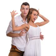 Surprised young couple on white background, isolated Stock Photos