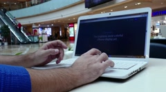 Apple store USA on laptop computer screen with modern Iphon 7 presentation Stock Footage