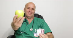 Specialist Doctor Recommending Treatment with Drugs or Cure with Fruits Vitamins Stock Footage