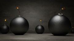 Falling bombs in concrete background. Stock Footage
