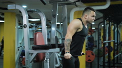 Young muscular man doing exercise at the gym Stock Footage