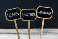 Business message LEARN ANOTHER LANGUAGE Stock Photos