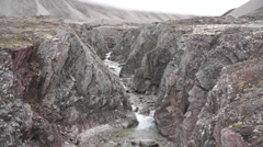 Stream and mountains at Perdalen. Svalbard, Spitzbergen Stock Footage