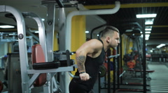 Side view of young muscular man doing exercise at the gym Stock Footage