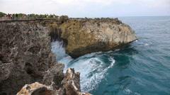 Blue ocean sea water waves crashing cape rocks, tidal wave splash crash rock Stock Footage