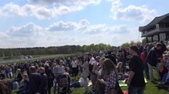 4k People waiting at horse racing course for the next race Stock Footage