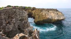 Waterblow at Nusa Dua Bali, sea ocean blue waves crashing volcanic rocks cape Stock Footage