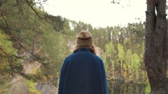 Girl goes to the quarry. Autumn Stock Footage