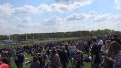 4k Timelapse panning people waiting at horse racing course for the next race Stock Footage