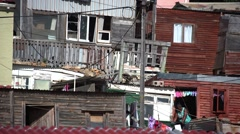 Long lense,compressed shot of shacks in informal settlement Stock Footage