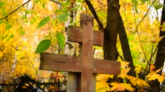 Cross in the cemetery in autumn Stock Footage