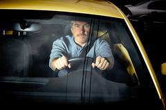 Tired man driving car at night. Stock Photos