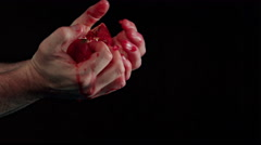 Juices dripping off male hands squashing pomegranate Stock Footage