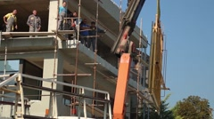 Huge Glass Reflects Construction Work Building House Workers Company Stock Footage