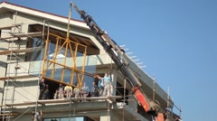 Enormous Glass Hoist Crane Construction Building House Workers Company Stock Footage