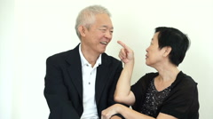Asian senior couple teasing and playing, love, fun healthy relationship Stock Footage