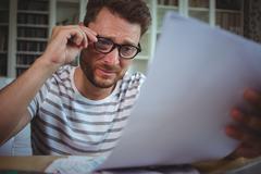 Worried man looking at his bills Stock Photos