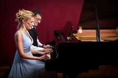 Two piano musician piano music playing,woman and man Stock Photos