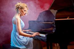 Beautiful woman musician piano music playing Kuvituskuvat