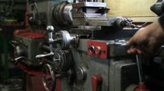 Lathe turning machine getting ready to work Stock Footage