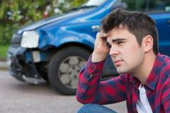Unhappy Driver With Damaged Car After Accident Stock Photos
