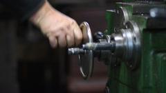 Hand steering adjustable wheel on lathe machine Stock Footage