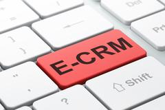 Business concept: E-CRM on computer keyboard background Stock Illustration