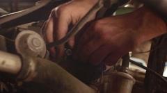 Mechanic repairing car in the garage repairing motor of buggy  Stock Footage