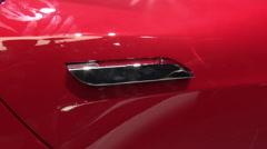 Tesla Model S P90D red in Paris 2016, door handle Stock Footage