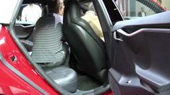 Tesla Model S P90D red in Paris 2016 Stock Footage