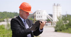 Concrete Factory Manager Inspecting Work Field and Taking Notes on Agenda Pages Stock Footage