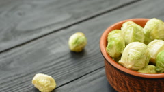 Fresh raw organic green brussel sprouts in a ceramic Stock Footage