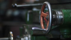 Mechanic operating old lathe machine Stock Footage